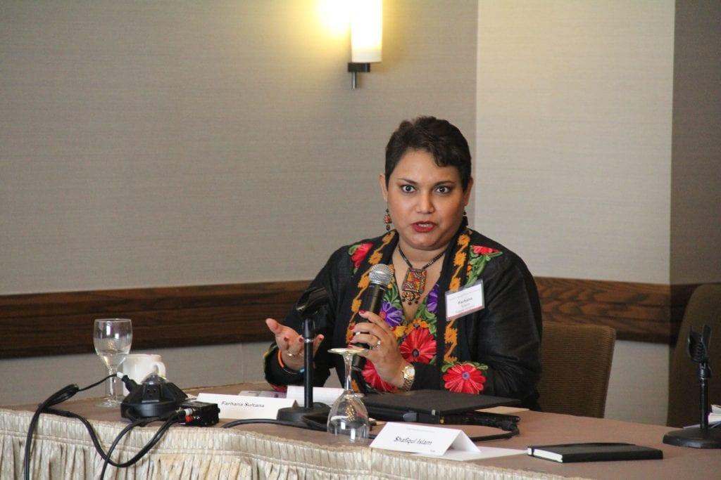 Dr. Farhana Sultana delivering a talk at Harvard University, 2014